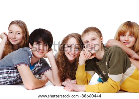 Teenagers group smiling, over white - stock photo