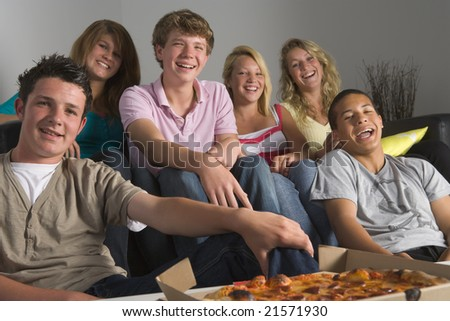Teenagers Having Fun And Eating Pizza - stock photo