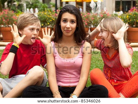 Teenagers having fun in a garden park setting. - stock photo