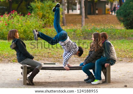 Teenagers having fun in the park on beautiful autumn day - stock photo