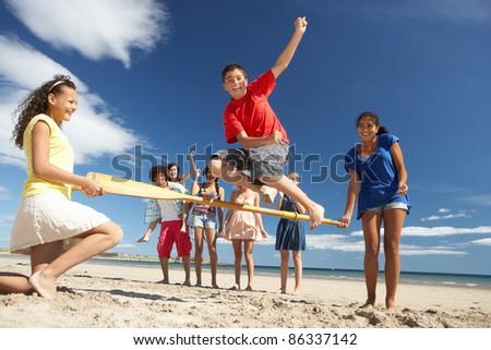 Teenagers having fun on beach - stock photo