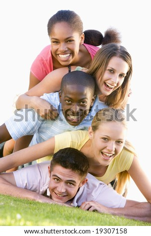 Teenagers Having Fun Outdoors - stock photo