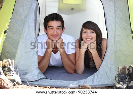 Teenagers in a tent - stock photo