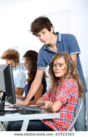 Teenagers in computing class - stock photo