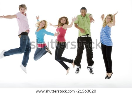 Teenagers Jumping In The Air - stock photo
