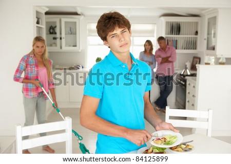 Teenagers not enjoying housework - stock photo