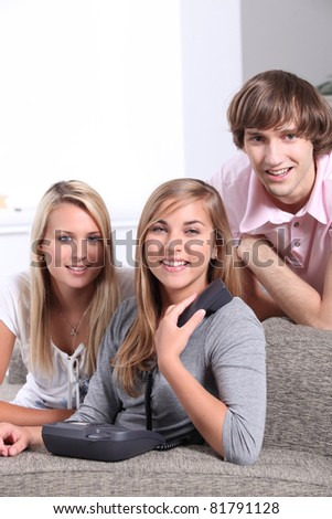 Teenagers on the phone - stock photo