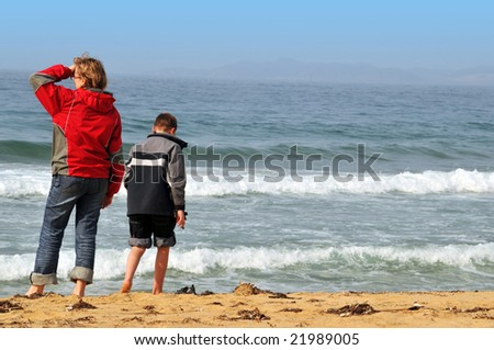 teenagers on the spring sea beach
