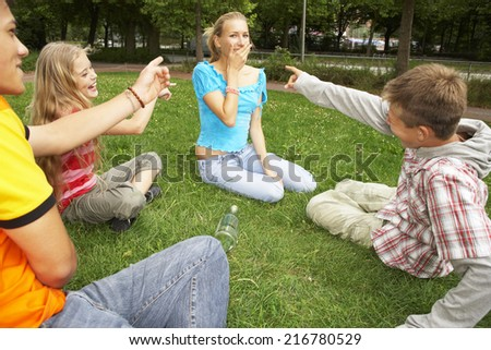 Teenagers playing in a park. - stock photo