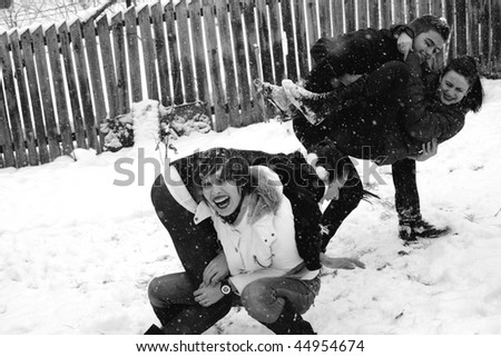 teenagers playing in winter season