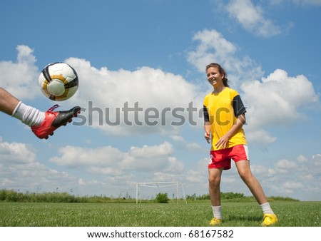 teenagers playing soccer - stock photo