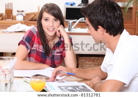 Teenagers revising at home - stock photo
