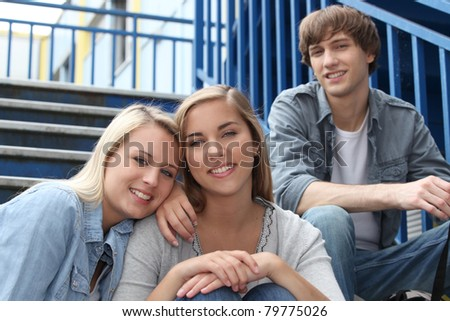 Teenagers sat on the steps - stock photo
