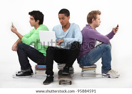 Teenagers sat together - stock photo