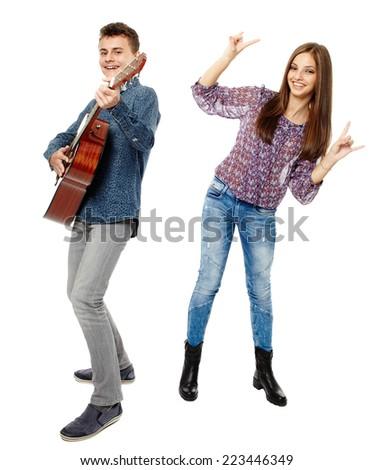 Teenagers singing and playing guitar, having fun, full body shot - stock photo