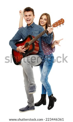 Teenagers singing and playing guitar, having fun, full body shot - stock photo