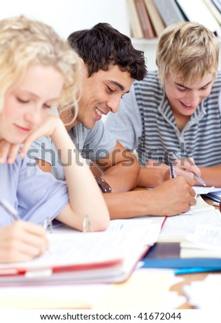 Teenagers studying in the library. Concept of education - stock photo
