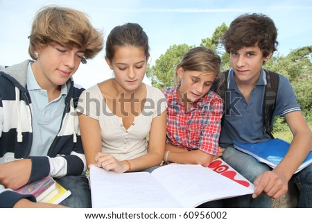 Teenagers studying outside the class - stock photo