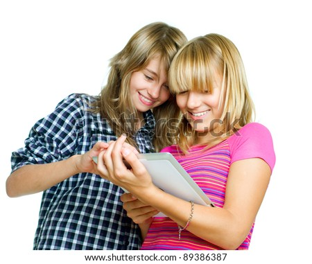Teenagers using tablet PC.Touchpad - stock photo