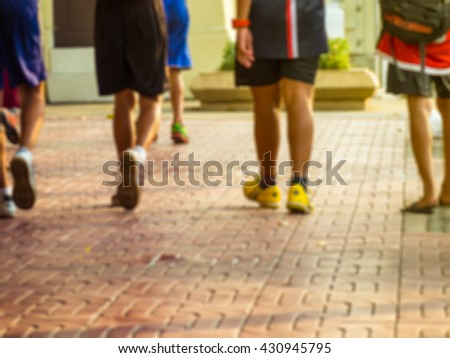 Teenagers walking back home after playing soccer and basketball. Young and sport concept. Blur motion. - stock photo
