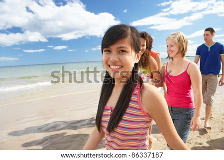 Teenagers walking on beach