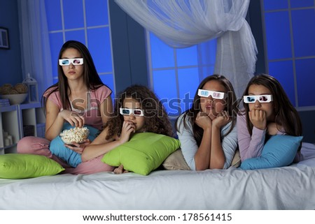 Teenagers watching 3-D movie  - stock photo