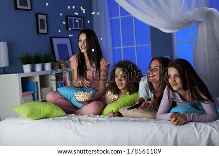 Teenagers watching funny movie - stock photo