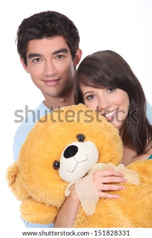 Teenagers with a large teddy - stock photo