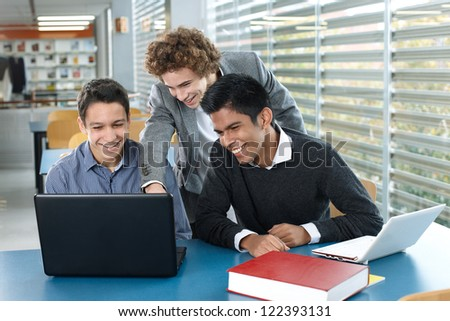 Teenagers with laptop - stock photo