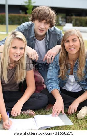 Teenagers working outside - stock photo