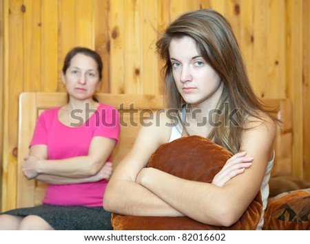 teenr daughter and mother having quarrel at home - stock photo