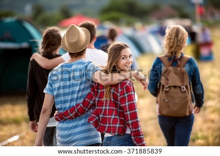 Teens at summer festival. Young teens at summer music festival. Funny group of young girls and boys at music festival. Happy teen at summer festival. - stock photo