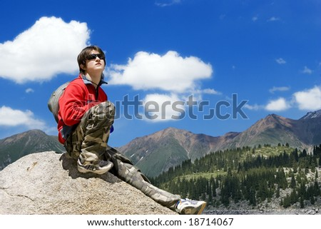 Teens boy in mountains hike in summer vocations, Tien Shan - stock photo