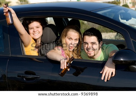 teens drinking alcohol in car - stock photo