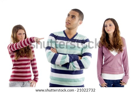 teens girl pointing towers boy and guy looking sideways against white background - stock photo