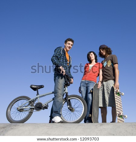Teens hang out at the skatepark - stock photo