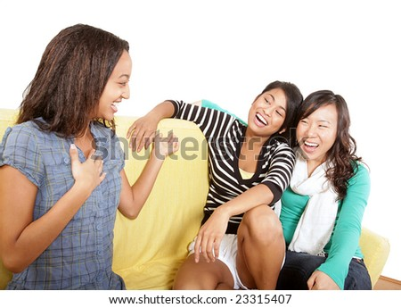 Teens laughing it up while hanging out together - stock photo