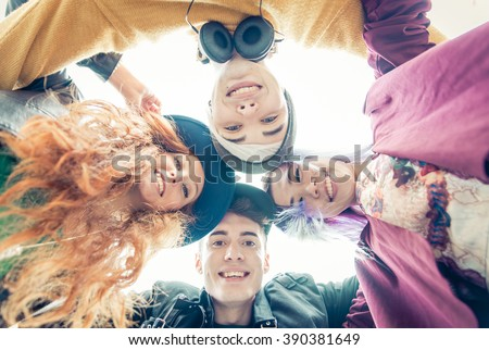 Teens portrait. group of teens hugging together and sharing good mood - stock photo