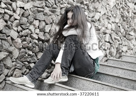Teens problems. Young woman alone at the city