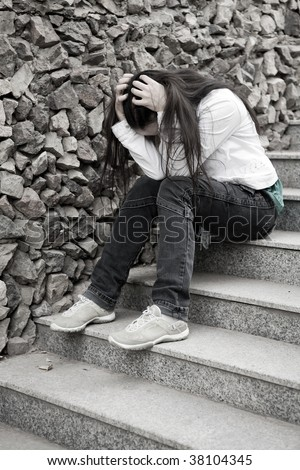 Teens problems. Young woman alone at the city - stock photo