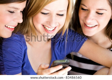 Teens with cellphone - stock photo