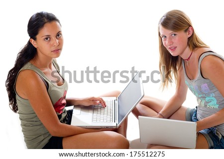 teens with laptop - stock photo