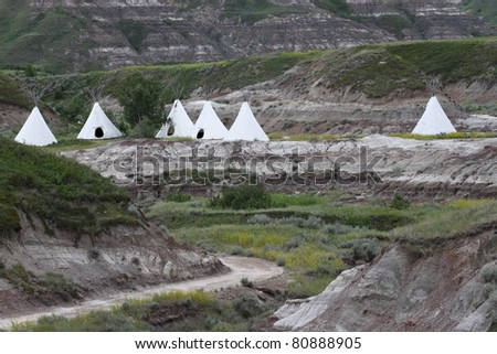 Teepees set up in the badlands of southern Alberta - stock photo