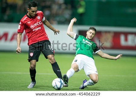 Teerasil Dangda (L) of Muangthong United. in action during  theThai Premier League 2016 Bangkok Glass FC.and Muangthong United at Leo Stadium on June 29,2016 in Thailand - stock photo