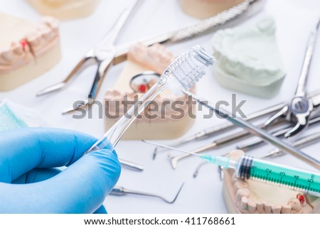 Teeth mold and basic dental tools on white surface