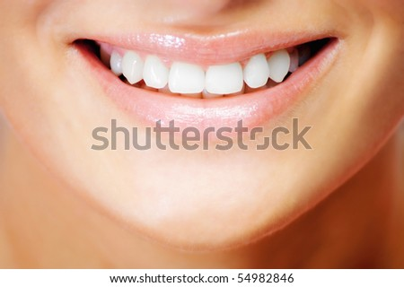 Teeth of a smiling young woman - stock photo