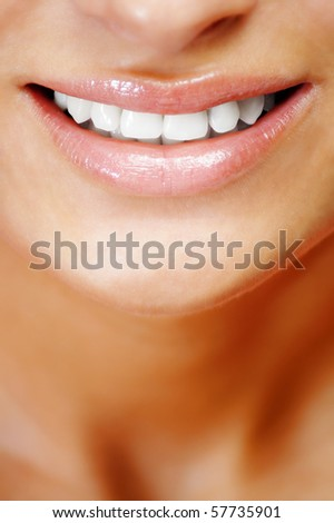 Teeth of a smiling young woman ,vertical - stock photo