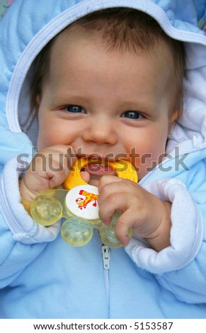 Teething baby - stock photo