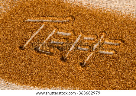 Teff, a gluten free ancient grain alternative  with the name spelled in it - stock photo