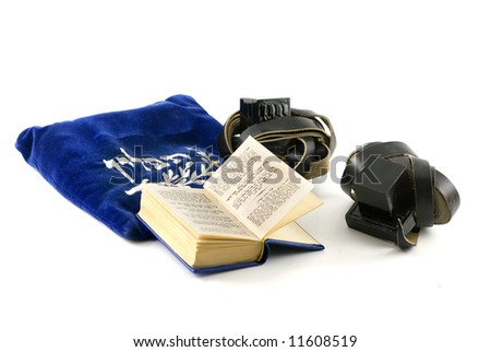 Tefillin - phylacteries worn by Jewish men for morning prayers, Siddur - Jewish prayerbook and bag isolated on white - stock photo